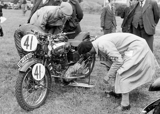 Photo #41 C Geffers 246cc Hercules [IIN 19611] a beautiful bike with much quality detailing being carefully scrutinies at weigh in in the ISDT 1937 (Courtesy Deryck Wylde)
