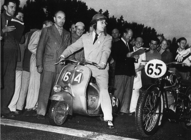 Photo of Carrini and his 98cc Vespa at the start ISDT 1951