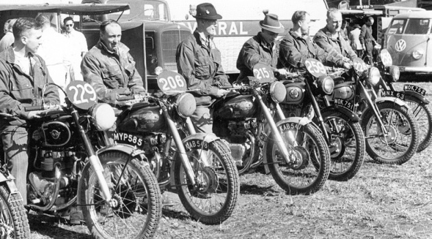 Photo - L to R - British rider line up Dick Clayton (Matchless), Don Evans (500 Royal Enfield twin), John Brittain (500 Royal Enfield twin), David Tye (BSA ), Peter Hammond (Triumph) and Tom Ellis (BSA). ISDT 1952 (courtesy Deryck Wylde collection)