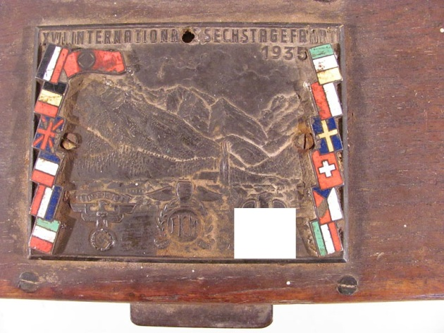 image - Cast commemorative plaque ISDT 1935 set on lid of wooden chest (found on eBay.de)