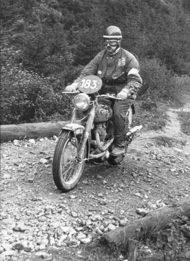 Photo - #183 Bob Ray rides by wearing the Green British Helmet in ISDT 1952