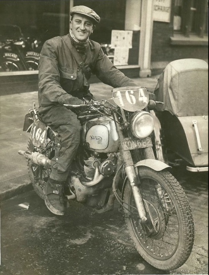 Photo of Eric Wilson, on his ex Works Norton 500 Dominator parked outside his workplace Victor Horsmans, the Liverpool Motorcycle Dealer. He rode the bike to and from the event iin Italy as well as picking up a Gold medal. ISDT 1951 (Courtesy Wilson Family Collection)
