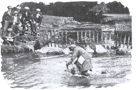 Image of W T Tiffin (Velocette) as his bike sinks out of site in the Asby splash ISDT 1927