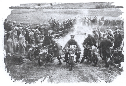 Image of #44 G E Rowley (AJS) through a number of drowned bikes with wet magnetos at the Asby Splash ISDT 1927