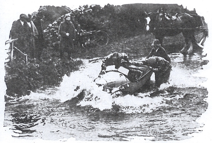Image of competitors struggling in high water ISDT 1927