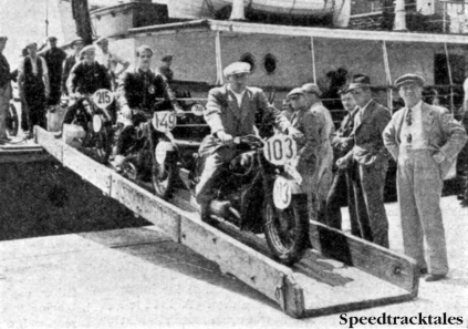 Photo - The German's have arrived! three of the German Contingent for the International Six Days Trial landing at Southampton last week. The two leading machines are BMWs and the thrid on the gang plank is a Zundapp. On the exterme right is a popular 'International' figure - the interpreter. ISDT 1937 (Speedtracktales collection)