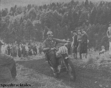 Photo - Army sargeant #111 Gordon Norton, a member of one of the Royal Enfield works teams, displays a nice line in body lean in forcing up a special test for bonus points. He was unlucky to lose his 'Gold' when he lost a single mark on time which relagated him to 'Silver' standard ISDT 1962 (Speedtracktales Collection)
