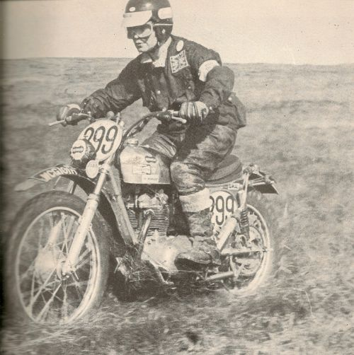Photo of #299 Ken Heanes firing his Triumph across some open going in the ISDT 1965