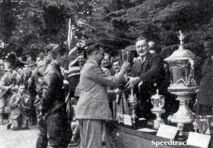 Photo- Graham Walker, Editor of 'Motor Cycling' handed the cup presented by the journal to the best Army team in the INternational Six Days to the Royal Tank Corps team, who rode BSA's during the proceedings ISDT 1938 (Speedtracktales Collection)