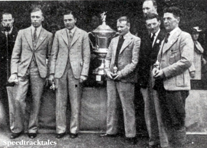 Photo - During the National Rally, the International Trophy was presented to the British Team, Vic Brittain, Jack Williams (Norton), Geo Rowley (AJS) and B Munday and Stuart Waycott (Velocette sc) ISDT 1938 (Speedtracktales Collection)