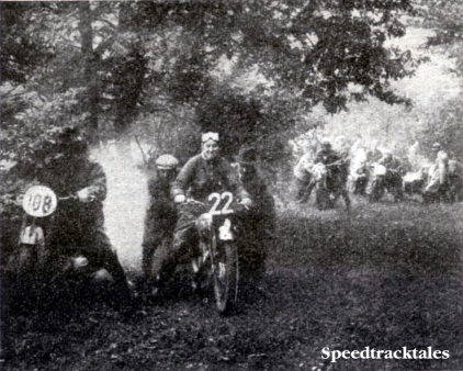 Photo #22 Mrs M L Anning (BSA) and #108 F Lindhardt (BMW) receiving assistance on Fron Bache. Observe the large group of riders in the background waiting for the opportunity to 'have a go' ISDT 1938 (Speedtracktales Collection)