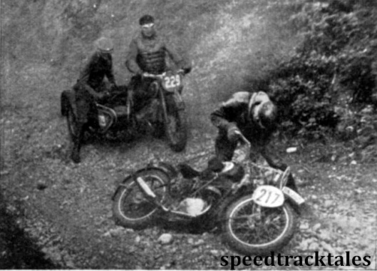 Photo - Where a sidecar is more stable than a solo. #229 H Zuur (600 BMW sc) has to wait to allow #217 L Wohlfahrt (245 Zundapp) to regain an even keel after a fall on the loose stones of the 'road'. ISDT 1939 (Speedtracktales Archive)