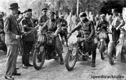 Photo - under the eyes of many other important officials, Major Watling gives a starting signal to #131 BQMS E Smith (347 Matchless), and #130 G Dotterweich (342 Victoria). Behind is #135 GE Rowley (347 AJS) of the British Trophy Team ISDT 1939 (Speedtracktales Archive)