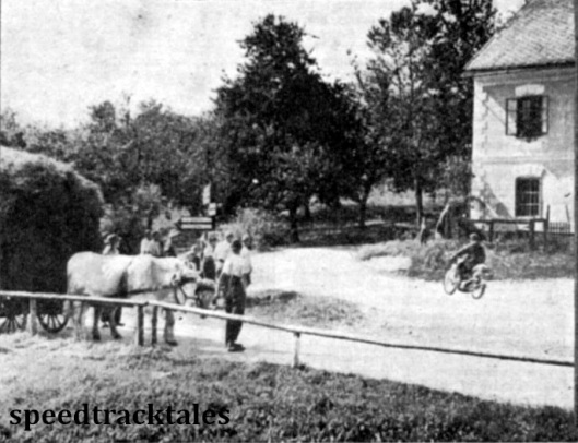 Photo - A bullock cart awaits while T Mooney (497 Ariel) passes through the village. ISDT 1939 (Speedtracktales Archive)