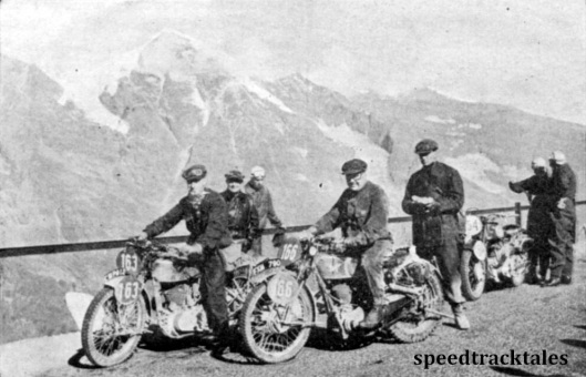 Photo - A group of British competitors pose for the camera amid the grandeur of the Grossglockner scenery. #163 is JJ Booker ( Royal Enfield) and #166 Colin Edge (347 Matchless). Behind the latter is AB Bourne the editor of 'the Motor Cycle'. ISDT 1939 (Speedtracktales Archive)