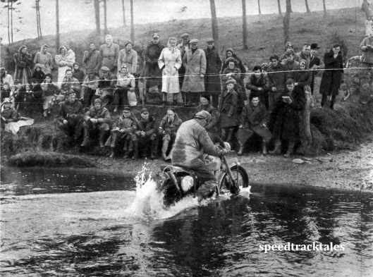 Photo - A mixed gallery watches #109 R. Wilkinson (348 Panther) trickle slowly through a water splash ISDT 1950 (Speedtracktales Archive)