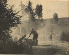 Photo - Dusty fume and stony boulder give a clear image of the arduousness of this six days trial. The moves of the people reflect the stress, which the riders have all day long. The two with #239 led by F Weber BMW 593 from the Kraftfahrtschule der Luftwaffe [Air Force motoring school], in the foreground of the picture, have won some time [in advance of the schedule], which they now use for some smaller work. ISDT 1939 (das Motorrad)