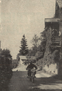 """Photo – This was on the second day, the """"5 lakes day, on the road parallel to the Lake """"Attersee"""". As long as only one solo rider comes along, the road seems quite wide, but imagine how tight it will be, if a sidecar outfit wants to overtake a bus, and they meet up there at the hump! The pictured rider is #217 NSKK- Truppführer [comparable to Sergeant] Wohlfahrt on Zündapp 245cc, a motorcycle that surprised some people with its performance. ISDT 1939 (das Motorrad)"""