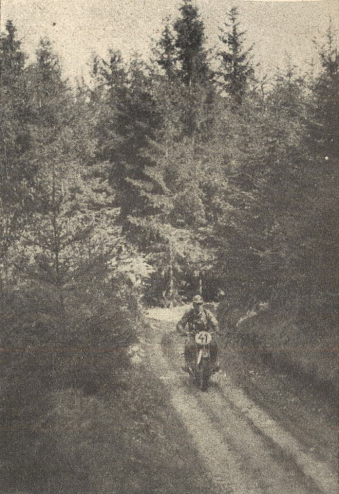 Photo - That was the typical terrain at the first day, narrow forrest tracks, interrupted by short boulder sections and large bathtubs with mud. Rider is #41 NSKK-Obersturmführer [comparable to 1. Lieutenant] Meinl of the Motorgruppe Ostmark on BMW R 51.ISDT 1939 [Ostmark was the name for former Austria, after Germany annexed this country] (das Motorrad)