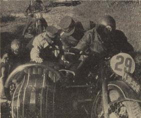 Photo – Sometimes it became very tough, and this picture shows, how Korpsführer Hühnlein [Head of the NSKK] himself gives a hand to help a stuck sidecar outfit. The rider is DDAC [Der Deutsche Automobil Club – the German Automobile Club] man #29 Schrimpf on the BMW R 17 outfit. ISDT 1939 (das Motorrad)
