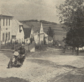 Photo – #110 The NSKK-Obertruppführer [comparable to staff sergeant] Röser, who right at his first appearance at Schönerlinde made people talk of him, did become an excellent off road rider. Here he can be seen with his BMW at a steep climb, on his way to the next to last checkpoint. ISDT 1939 (das Motorrad)