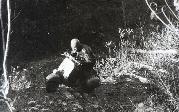 Photo Scooter rider Natale Biasci tries covering ground ISDT 1951