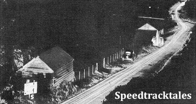 photo - The road is streaked with Orange threads of lights during Tuesday's run. Riders are travelling North on A483, which leads towards Newtown. ISDT 1954 (Speedtracktales Archive)