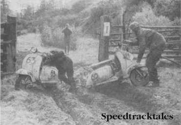 Photo Unfair to small-wheeled vehicles! Alan Kimber (left) and Roy King manhandle their Lambrettas out of footboard deep ruts at Prebersee ISDT 1960