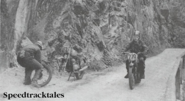 Photo - Stuck on the Stein Pass! #272 R Hvezda of Czechoslovakia mends a front tyre puncture on his Jawa while Britain's Trophyman #279 Colin Moram (AJS) presses on. ISDT 1960