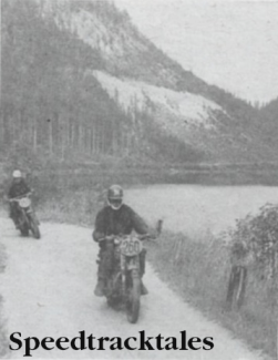 Photo - The still waters of a roadside lake frame the hasty rivals  - Peter Fletcher, British Trophy Teamster whose Royal Enfiled leads Poland's S Frantisek on his Junak ISDT 1960