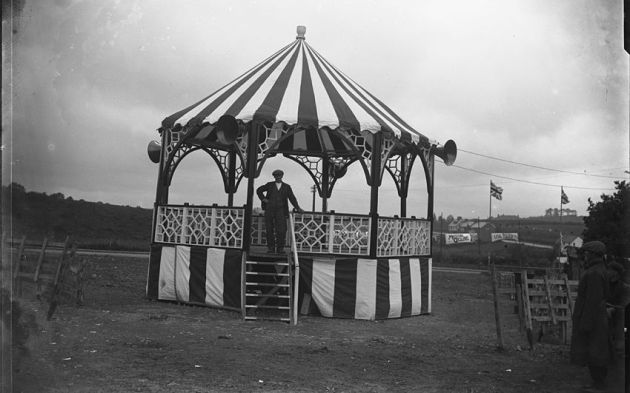 Photo of the Bandstand in Llandrindod Wells With flags and banners in the background connected to the ISDT 1938 (Courtesy National Library of Wales Rusham Roberts collection)