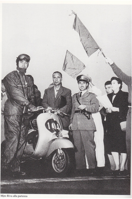 Photo of Vespa rider and group of dignitaries at start ISDT 1951
