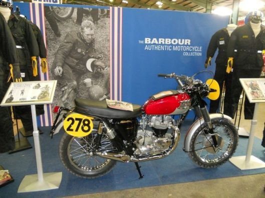 Photo - Ace Classic's replica of the Steve McQueen ISDT Triumph at Stafford on the Barbour stand