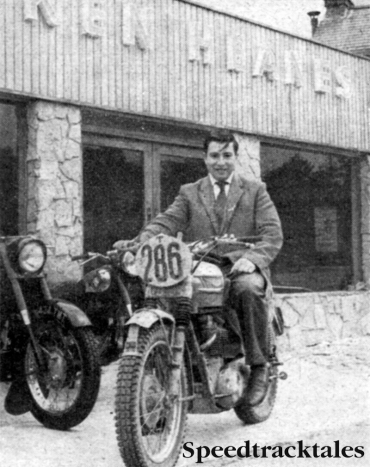 Photo - Ken Heanes plus ISDT Triumph outside his extended premises at Fleet, Hants. The attractive facade like all the other building work, was done by Ken and his Uncle.