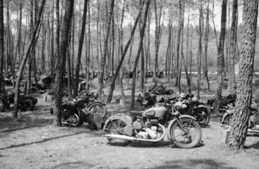 Photo - Abandoned British army motorcycles at Monce-en-Belin near Le Mans, 13 June 1940. (Image courtesy Imperial War Museum)