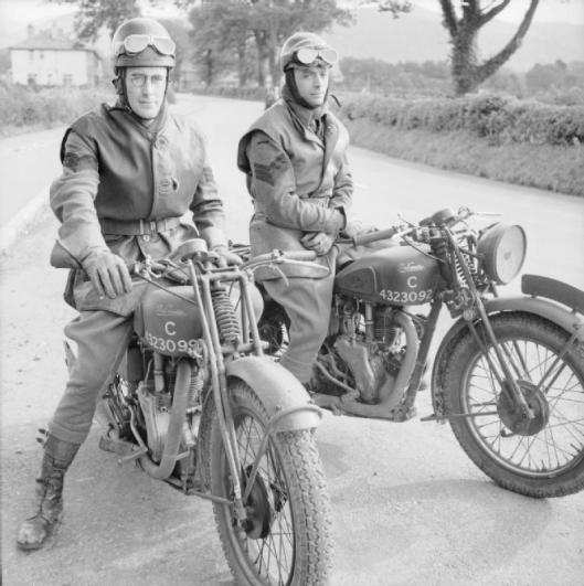 Photo - Sgt J H 'Crasher' White and Sgt Freddie Frith, former racing and trials riders, now motorcycle instructors at an RASC driving and maintenance school at Keswick in the Lake District, October 1942. (Image courtesy Imperial War Museum)