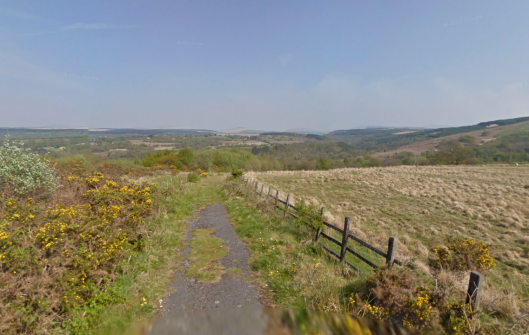Photo - Where the tarmac runs out, with a wonderful view to distant moorlands on route Day 1 ISDT 1938 (Google Streetview)