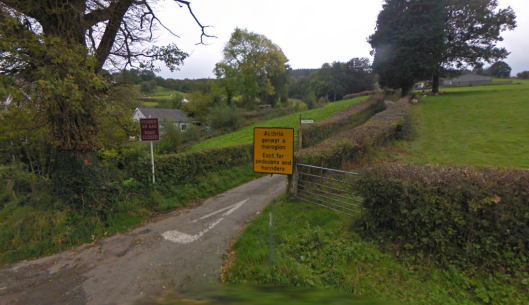 Photo - Matching insults erected at the Pentre Back end of the track at the A40 junction on route Day 1 ISDT 1938 (Google Streetview)
