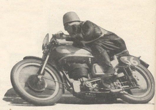 JH ('Crasher') White (Norton) assumes a characteristic crouch as he heels over his Norton in the Grand Prix of Europe , the 350cc class of which he won at 79.78mph (Speedtracktales collection)
