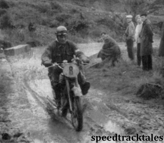 photo - member of the Czech Trophy team Alois Roucka (123cc CZ) keeps his boots dry on the muddy track by-passing Misecky ISDT 1957 (Speedtracktales archive)