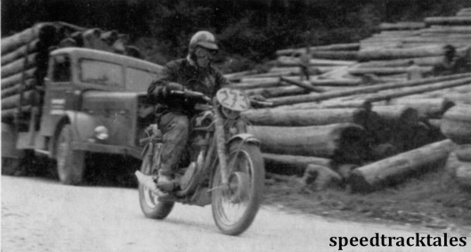 photo - British Trophy teamster, Tim Gibbs (497cc Matchless) hurries past a logging camp ISDT 1960 (Speedtracktales archive)