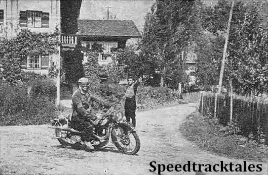 photo - Vic Britain (490 Norton) swerves a curve on the road approaching Unterwössen, a village near the end of Thursday's route. ISDT 1939 (Speedtracktales Collection)