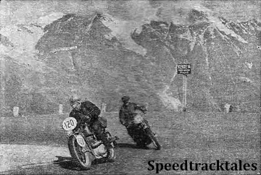 "photo - Dusting it up on the Grossglockner Pass. The ""racers"" are #120 G. Keitel (350 DKW) in the lead with J.H. Wood (343 Triumph following him. Some idea of the glorious scenery can be gathered from the mountains in the background. ISDT 1939 (Speedtracktales Collection)"