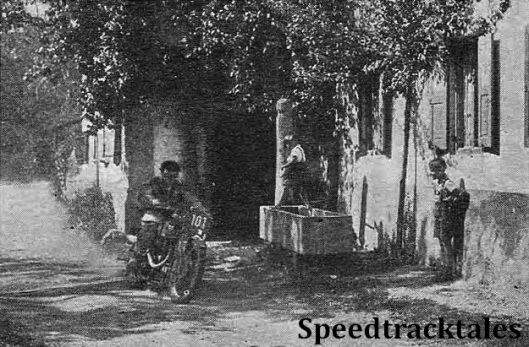 "photo - ""You can lead a horse to water..."" ! Sergt. F.M. Rist (496 BSA) passes through the outskirts of Unterwössen. ISDT 1939 (Speedtracktales Collection)"