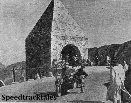 photo - Right on the top of the Grossglockner Pass is the Dolfuss Memorial, the impressive archway through which L.E.C Hall has just passed. It was included in Wednesday's run. ISDT 1939 (Speedtracktales Collection)