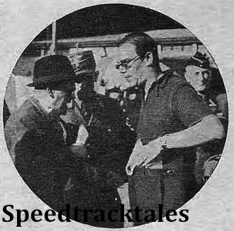 photo - Peter Chamberlain in an argument with a German official - that is, if expressions are any criterion. ISDT 1939 (Speedtracktales Collection)