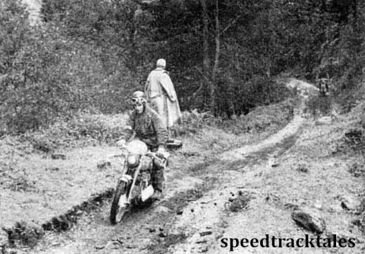 Photo - British Trophy teamster Jack Stocker (692 Royal Enfield) leads a rival down a track in the Mandling District which typifies the terrain in the trial. ISDT 1952 (Speedtracktales Collection)