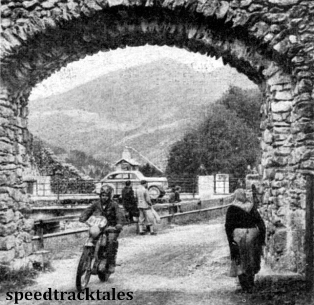 Photo - HJ Marriott (490 Norton) effectively framed on a road in Mandling while and elderly villager watches the trial go by. ISDT 1952 (Speedtracktales Collection)
