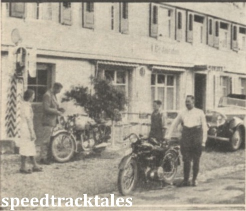 Photo - The editor with his Triumph Twin after crossing the border into Switzerland. In the foreground, alongside a Condor machine is a kindly Swiss Hotelier who helped the Editor change a fork spring.  ISDT 1939 (Speedtracktales Collection)