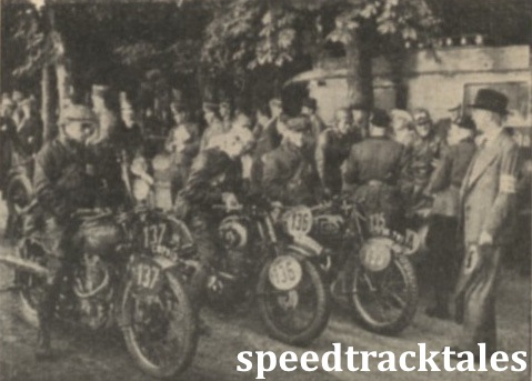 "Photo - Zero hour! A batch of competitors waiting on the starting line at Salzburg for Major Watling to give the signal to set off on the day's run. Left to Right are C.N Rogers (246 Royal Enfield, of the British ""B"" Vase team, H Kirchberg (343 DKW) and George Rowley (347 AJS) of the British Trophy Team. ISDT 1939 (Speedtracktales Collection)"